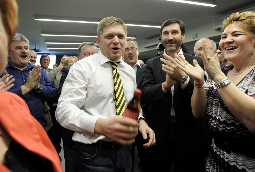 Robert Fico (center), chairman of the Smer-Social Democrats (Smer-SD), celebrates with party members in the early morning of Sunday, March 11, 2012, in Bratislava, Slovakia, after the party won early elections on Saturday with a comfortable majority in parliament. (AP Photo/CTK, Jano Koller)