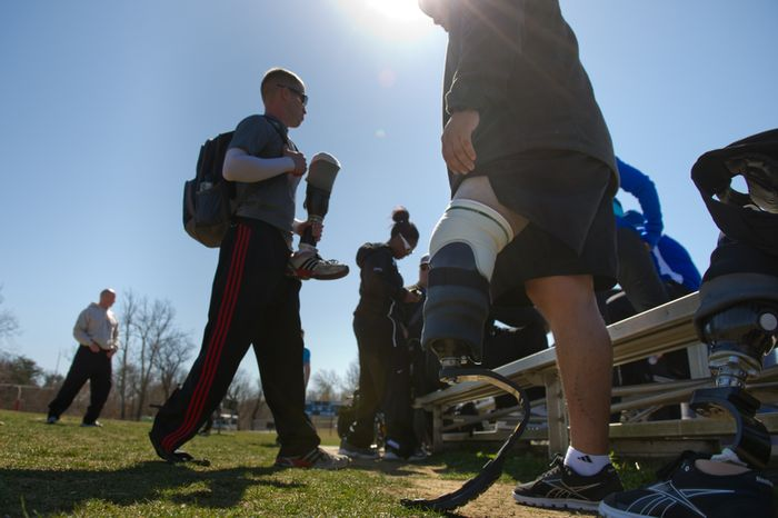 Spc. Brynden Keller of Indianapolis, Ind. who lost his leg outside of Kandahar Providence in Afghanistan, second from left, and Sgt. Julio Larrea of New York, N.Y.,  who lost his leg in 2010 from a vehicle rollover in Afghanistan get ready to compete in races with other wounded soldiers and Army veterans from across the United States in the Army Warrior Games clinics for a chance at a spot on the Army Warrior Games team, Fort Meade, Md., Sunday, March 11, 2012. The 2012 Warrior Games, held April 30th - May 5th in Colorado Springs, Colo., features representatives from Army, Navy, Air Force, Marines and Special Operations and will compete for gold metals in archery, cycling, wheelchair basketball, shooting, swimming, track and field, and sitting volleyball. (Andrew Harnik/The Washington Times)