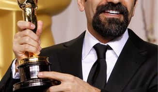 "A ceremony in Iran to honor director Asghar Farhadi, here with his best-foreign-language-film Oscar for ""A Separation,"" was canceled abruptly Monday. Hard-liners reportedly were upset with the film's treatment of problems in Iranian society. (Associated Press)"