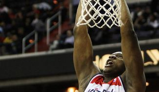 Wizards forward Kevin Seraphin, dunking against Golden State on March 5, played perhaps his best game of the season in Washington's 106-101 win over the Los Angeles Lakers two days later. (Associated Press)
