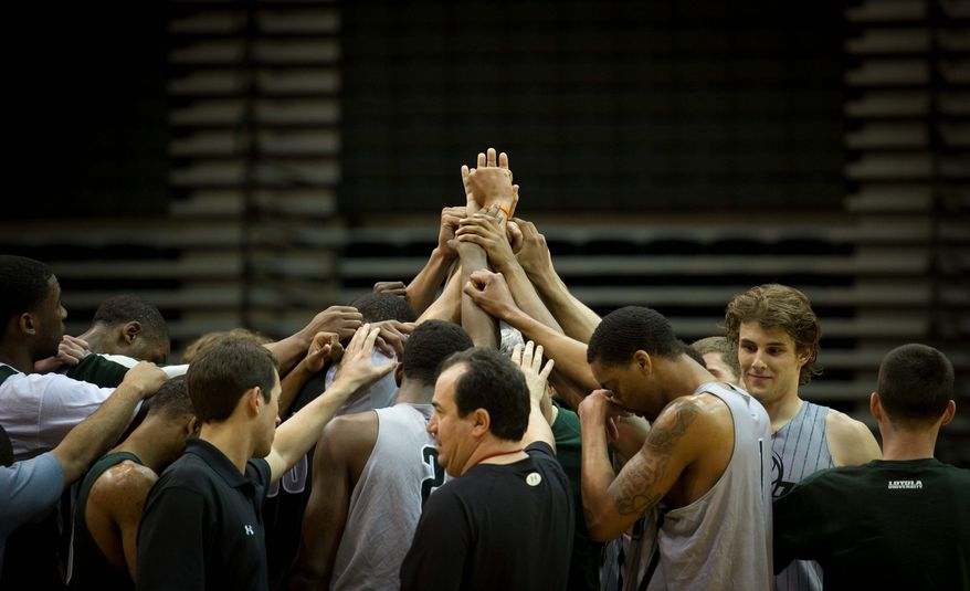 Loyola's team gathers for a huddle after practicing at Reitz Arena on Monday. Loyala, a No. 15 seed, faces Ohio State in the second round of the NCAA tournament Thursday. (Rod Lamkey Jr./The Washington Times)