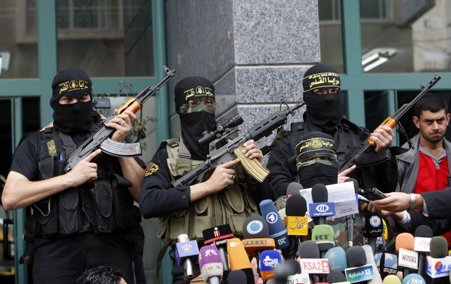 A Palestinian Islamic Jihad militant talks March 12, 2012, during a press conference in Gaza City. Israeli airstrikes killed two Palestinian militants and a schoolboy in the Gaza Strip earlier in the day and Palestinian rocket squads barraged southern Israel, in escalating fighting that has defied international truce efforts. (Associated Press)