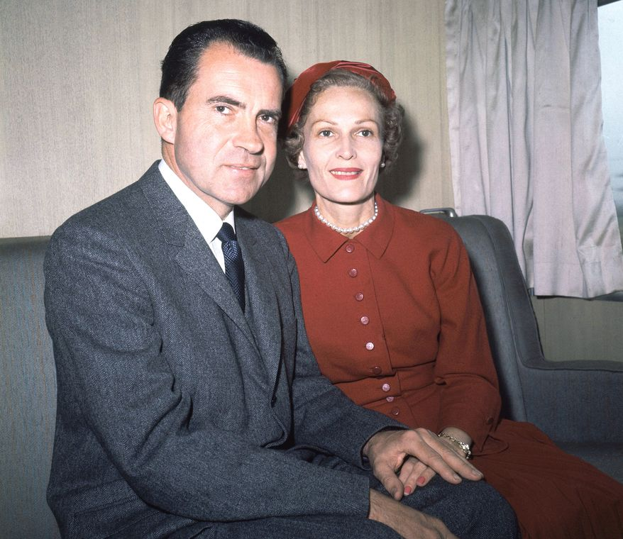 ** FILE ** Vice President Richard Nixon and his wife, Pat, pose for photos while campaigning for the presidency at Rockefeller Center in New York in June 1960. (AP Photo)
