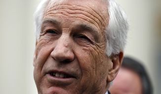 ** FILE ** Jerry Sandusky, a former Penn State assistant football coach charged with sexually abusing boys, speaks to the media at the Centre County Courthouse in Bellefonte, Pa., on Friday, Feb. 10, 2012, after a bail hearing. (AP Photo/Alex Brandon, File)