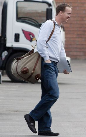 Quarterback Peyton Manning pays a visit to the Arizona Cardinals Training Facility in Tempe, Ariz., Sunday March 11, 2012. Manning is searching for a new team. (AP Photo/The Arizona Republic, Cheryl Evans)
