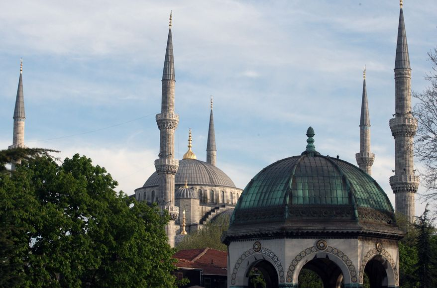The Sultan Ahmed Mosque (top), also called the Blue Mosque, represents the mournful character of Istanbul epitomized by Nobel laureate Orhan Pamuk. The faded facades in the old districts are now surrounded by a striking frenzy of expansion that threatens the city's heritage, environment and identity. (Associated Press)