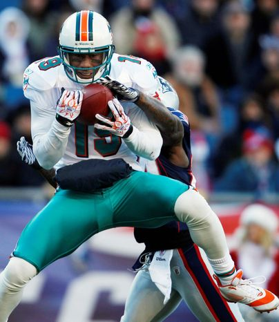 Brandon Marshall caught at least 100 passes each year from 2007 through '09 with Denver. He had 81 receptions for 1,214 yards and six touchdowns with Miami last season. (Associated Press)