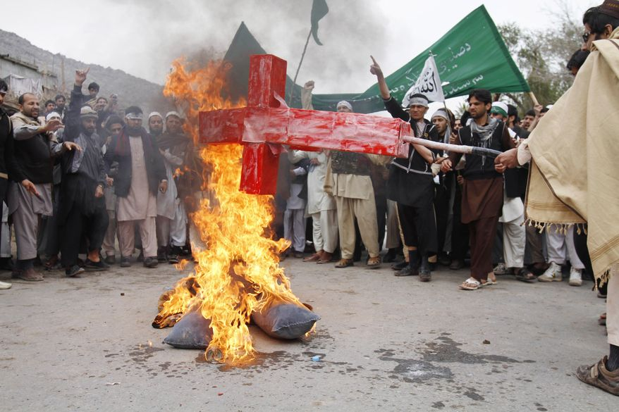 Afghans burn an effigy of U.S. President Obama during a protest in Jalalabad, Afghanistan, on Tuesday, March 13, 2012, following Sunday's killing of civilians in Kandahar province. (AP Photo/Rahmat Gul)