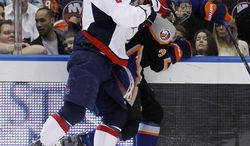 New York Islanders' Travis Hamonic (3) is checked by Washington Capitals' Alex Ovechkin during the first period of an NHL game in Uniondale, N.Y., Tuesday, March 13, 2012. The Capitals won 5-4 in a shootout. (AP Photo/Paul J. Bereswill)