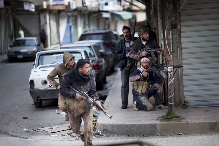 Syrian rebels take position during clashes with government forces in Idlib, Syria, on Sunday, March 11, 2012. (AP Photo/Rodrigo Abd)