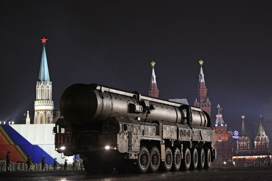 **FILE** A Russian army Topol ballistic missile mounted on a mobile launcher is seen May 4, 2011, during a dress rehearsal for the 2011 Victory Day military parade. (Associated Press)