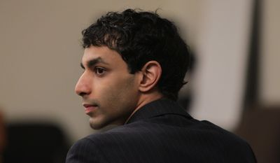 Dharun Ravi listens to testimony March 12, 2012, during his trial at the Middlesex County Courthouse in New Brunswick, N.J. Ravi, 20, is accused of using a webcam to spy on his roommate's intimate encounter with another man. His roommate, Tyler Clementi, committed suicide in September 2010, just days after the alleged spying. (Associated Press/The Star-Ledger)