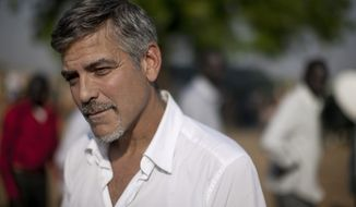** FILE ** In this Jan. 9, 2011 file photo, George Clooney stands outside a polling station in Juba, then capital of southern Sudan. Actor and human rights activist George Clooney made a quiet visit to a volatile border region between Sudan and South Sudan last week, ahead of testimony he's giving before a U.S. Senate committee on Wednesday, March 14, 2012. (AP Photo/Pete Muller, File)