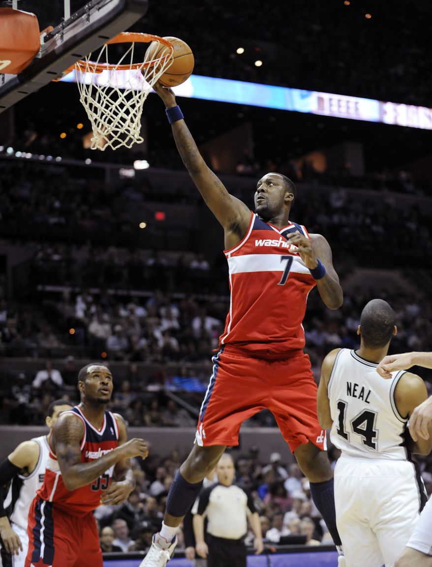 Washington Wizards forward Andre Blatche scores over San Antonio Spurs guard Gary Neal during the second half of an NBA game, Monday, March 12, 2012, in San Antonio. (AP Photo/Bahram Mark Sobhani)