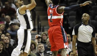 San Antonio Spurs guard Tony Parker of France shoots a three-point basket over Washington Wizards guard John Wall during the first half of an NBA basketball game Monday, March 12, 2012 in San Antonio. (AP Photo/Bahram Mark Sobhani)