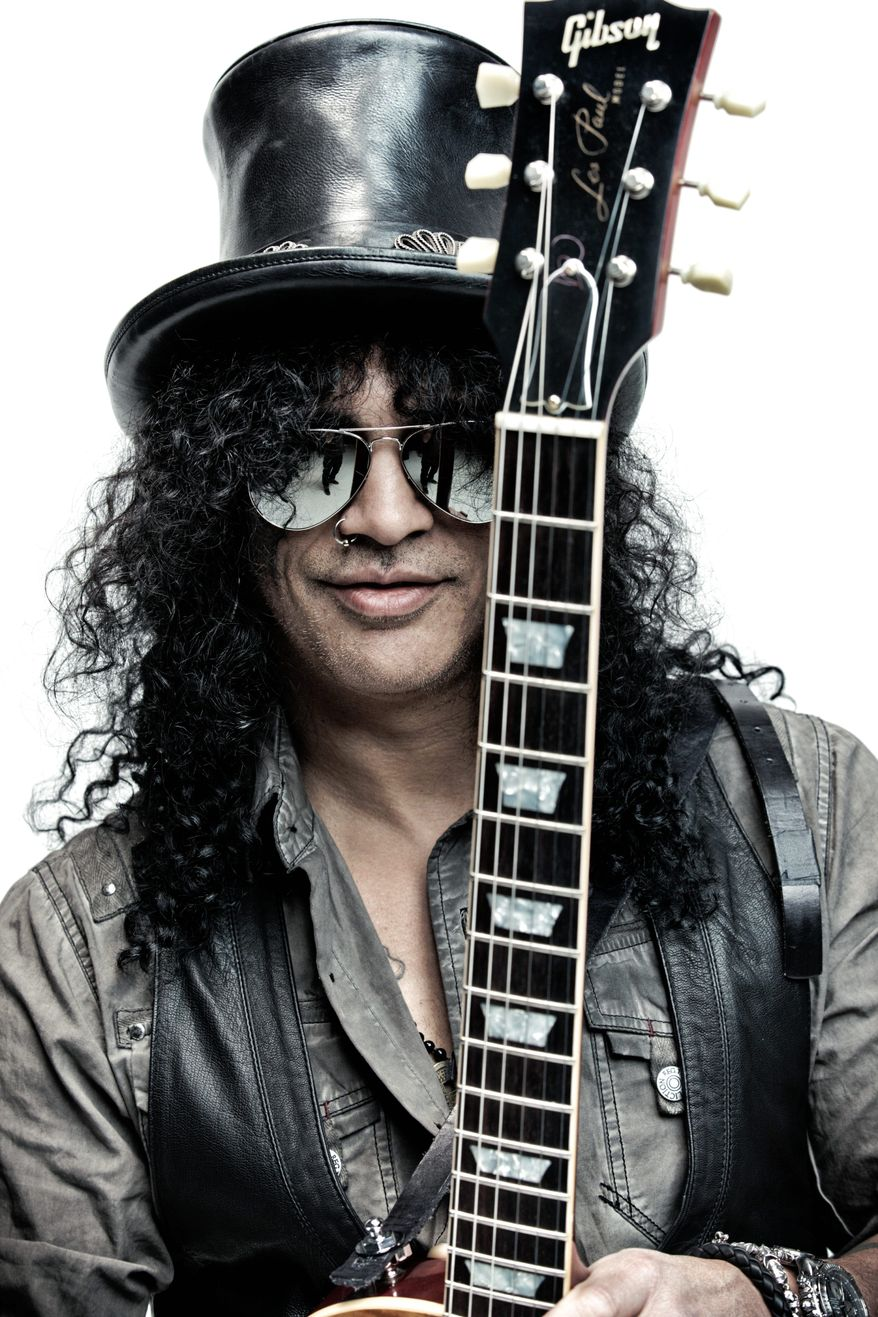 This is an undated image of rock guitarist Slash made available by Roadrunner Records on Tuesday March 13, 2012. Will Guns N' Roses reunite for their induction into the Rock and Roll Hall of Fame? Behind his dark glasses, hat and big hair, their former guitarist Slash is staying noncommittal on the subject. (AP Photo/ Roadrunner Records)