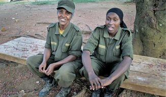 Fatuma Hassan Noor (top, left) and her daughter Amal Ahmed take a break from military training in Ibanda, Uganda. Fellow Somalis are being trained through a European Union program designed to provide a force that will contribute to the stabilization of Somalia. Ms. Noor instructs trainees in combat medical care using a mannequin (above). (Associated Press)