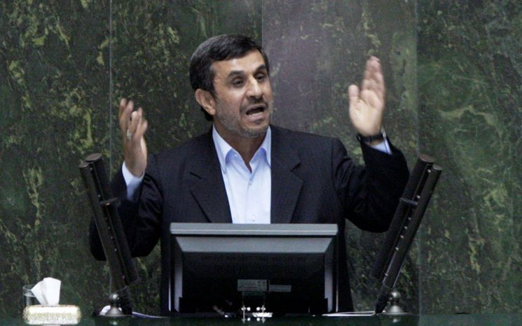 Iranian President Mahmoud Ahmadinejad answers questions in an open session in parliament in Tehran on Wednesday, the first president in the country's history to be hauled before the legislature, a serious blow to his standing in a conflict pitting him against lawmakers. (Associated Press)