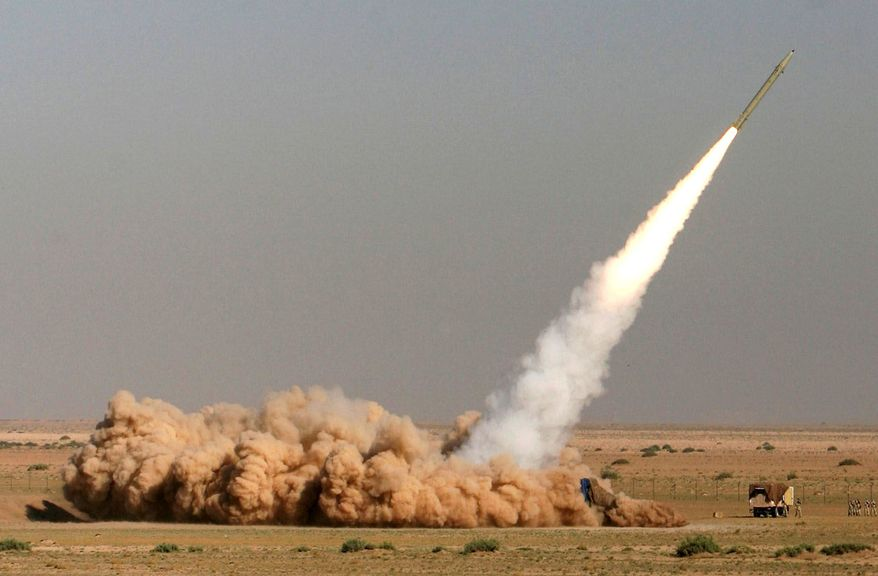 A Fateh missile of the Iranian Revolutionary Guard Corps is launched in a September 2009 drill near the city of Qom, 80 miles south of Tehran, in a show of force. Iran would likely retaliate for an Israeli attack with such missiles. (Associated Press)