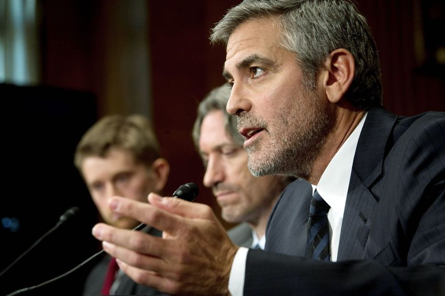 George Clooney answers questions from the Senate Foreign Relations Committee on horrors he saw while visiting Sudan. With him are human rights activist John Prendergast (center) and Jonathan Temin of the United States Institute of Peace. (Rod Lamkey Jr./The Washington Times)