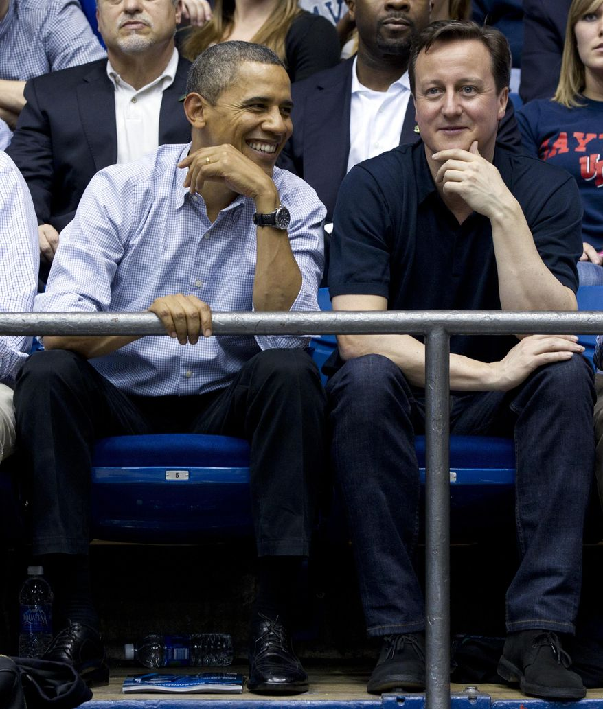 President Obama and British Prime Minister David Cameron attend the Mississippi Valley State-Western Kentucky basketball game in first-round NCAA tournament play on Tuesday, March 13, 2012, at the University of Dayton Arena in Dayton, Ohio. (AP Photo/Carolyn Kaster)