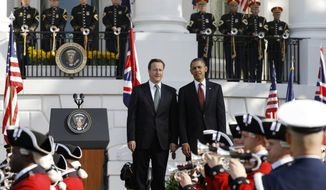 President Obama welcomes British Prime Minister David Cameron during an official arrival ceremony on the South Lawn of the White House in Washington on Wednesday, March 14, 2012. (AP Photo/Charles Dharapak)