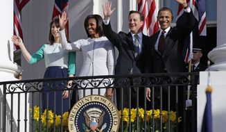 Waving from the balcony of the White House in Washington on Wednesday, March 14, 2012, are (from left) Samantha Cameron, wife of British Prime Minister David Cameron; first lady Michelle Obama; Mr. Cameron; and President Obama. (AP Photo/Carolyn Kaster)