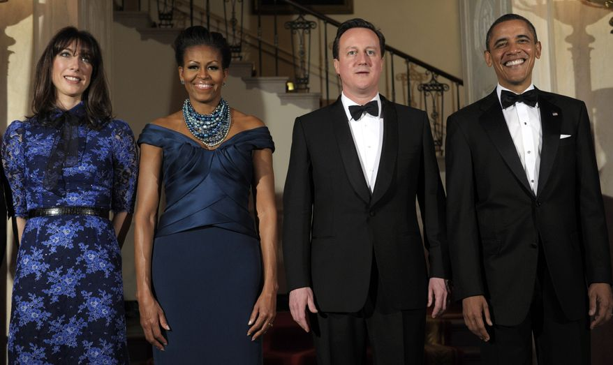 President Obama and first lady Michelle Obama pose for an official photo with British Prime Minister David Cameron and his wife, Samantha, at the White House on March 14, 2012, before a State Dinner. (Associated Press)