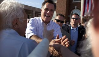 Republican presidential candidate, former Massachusetts Gov. Mitt Romney greets supporters at campaign stop at William Jewell College on Tuesday, March 13, 2012 in Liberty, Mo. (AP Photo/Evan Vucci)