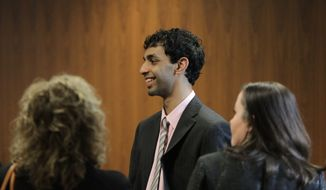Former Rutgers student Dharun Ravi (center) stands in the hallway with family members during a break in his trial at the Middlesex County Courthouse in New Brunswick, N.J., on Tuesday, March 13, 2012. (AP Photo/The Star-Ledger, John O'Boyle, Pool)