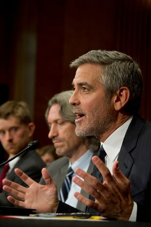 Actor George Clooney (right) responds March 14, 2012, to questions at the Dirksen Senate Office Building on Capitol Hill during a Senate Foreign Relations Committee hearing on Sudan and South Sudan. To his right are John Prendergast (center), co-founder of Satellite Sentinel Project and Enough Project, and Jonathan Temin, director of the United States Institute of Peace's Sudan program. (Rod Lamkey Jr./The Washington Times)