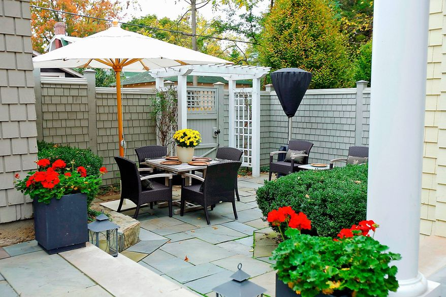 The multilevel flagstone patio provides seating and dining areas as well as garden beds.