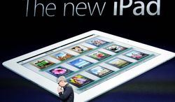 **FILE** Apple CEO Tim Cook clasp his hands March 7, 2012, while announcing the new iPad during an Apple event in San Francisco. (Associated Press)