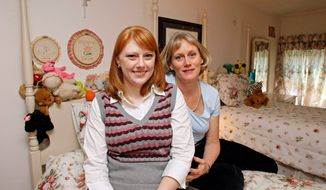 Melissa Jenkins sits with her mother Diana, right, on her childhood bed where she has been sharing her old room with her younger sister on Saturday, April 19, 2008, in North Reading, Mass. Melissa moved back home to live with her parents to find work after graduating college last year. (AP Photo/Greg M. Cooper)