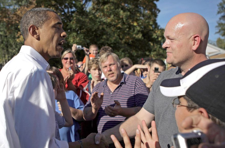 ** FILE ** Then-Democratic presidential candidate, Sen. Barack Obama, D-Ill., left, talks to plumber Joe Wurzelbacher in Holland, Ohio, Sunday, Oct. 12, 2008. (AP Photo/Jae C. Hong)