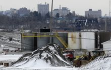**FILE** A brine injection well owned by Northstar Disposal Services LLC is seen Jan. 4, 2011, in Youngstown, Ohio, with the skyline of Youngstown in the distance. (Associated Press)