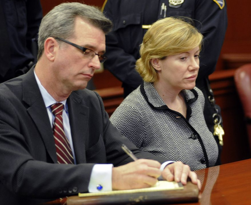 Anna Gristina, who has been charged with promoting prostitution, appears in court in New York on Monday, March 12, 2012, with Peter Gleason, one of her lawyers, who has offered to put up his own apartment as bail for her. (AP Photo/Louis Lanzano)