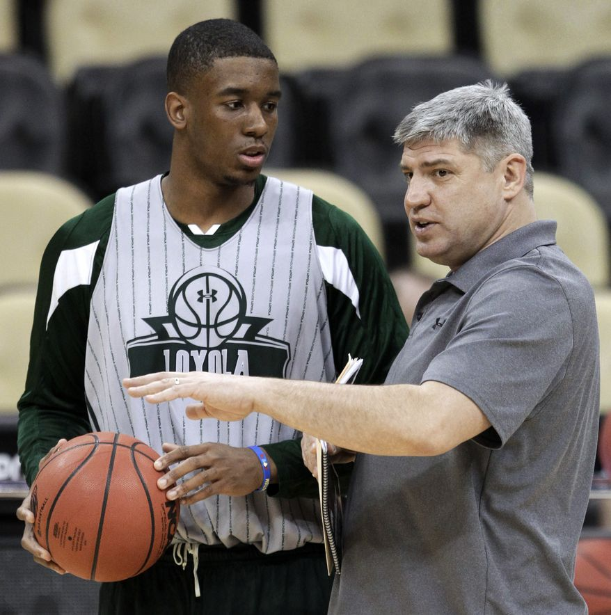 Loyola coach Jim Patsos, right, talks with Jordan Latham during practice in Pittsburgh, Wednesday, March 14, 2012. Loyola plays Ohio State in an NCAA men's college basketball tournament second-round game Thursday. (AP Photo/Gene J. Puskar)