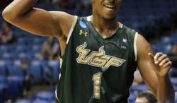 South Florida Bulls forward Ron Anderson Jr. holds up the bulls sign as he is taken out of their NCAA tournament first-round college basketball game against California, Wednesday, March 14, 2012, in Dayton, Ohio. South Florida won the game 65-54. (AP Photo/Skip Peterson)