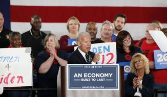Vice President Joseph R. Biden Jr. campaigns at a union hall in Toledo, Ohio, on Thursday, March 15, 2012. (AP Photo/Madalyn Ruggiero)