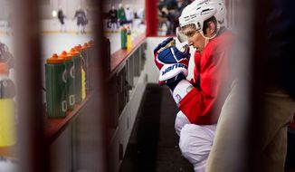 Washington Capitals left wing Alex Ovechkin sits on the bench March 15, 2012, after colliding with teammate Mike Knuble during a morning practice at Kettler Capitals Iceplex in Arlington, Va. (Andrew Harnik/The Washington Times)