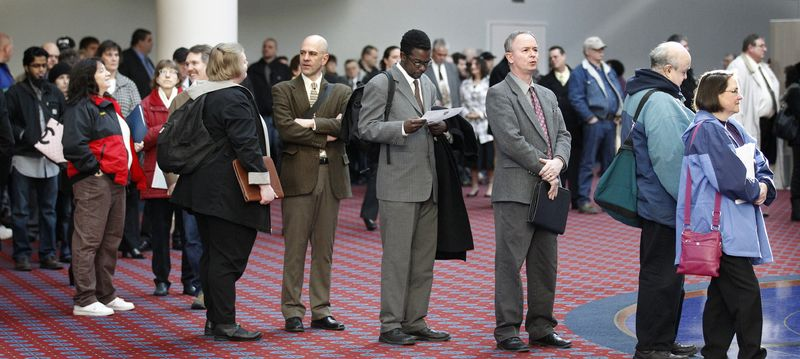 Job seekers stand in line during the Career Expo job fair on Wednesday, March 7, 2012, in Portland, Ore. (AP