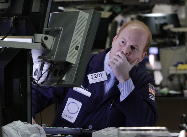 Specialist Michael Scavone works at his post on the floor of the New York Stock Exchange on Thursday, March 15, 2012, in New York. (AP Photo/Richard Drew)