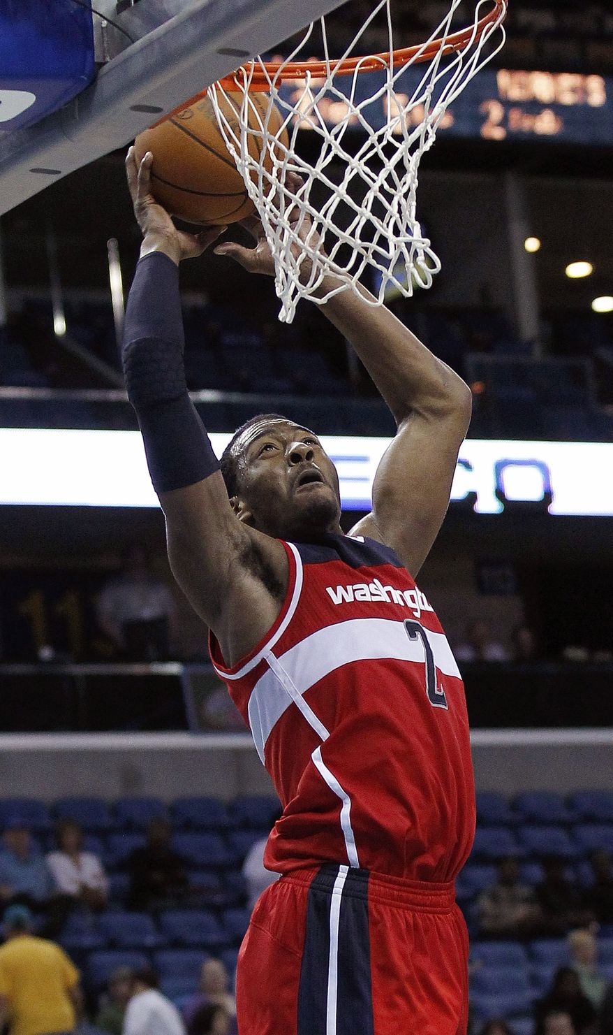 Washington Wizards point guard John Wall scores in the second half against the New Orleans Hornets in New Orleans, Thursday, March 15, 2012. The Wizards defeated the Hornets 99-89. (AP Photo/Bill Haber)