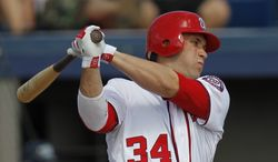 Washington Nationals' Bryce Harper bats against the New York Yankees during a spring training game in Viera, Fla., Thursday, March 15, 2012. (AP Photo/Paul Sancya)