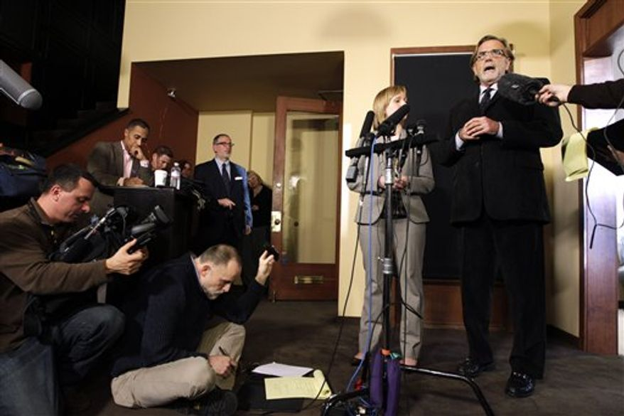 Attorneys John Henry Browne, right, and Emma Scanlan, second from right, talk to reporters, Thursday, March 15, 2012, in Seattle. Browne and Scanlan will be representing a U.S. soldier accused of killing 16 Afghan civilians. (AP Photo/Ted S. Warren)