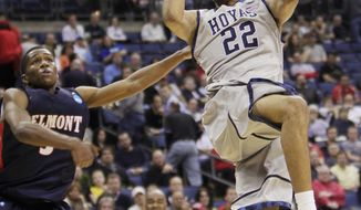 Georgetown's Otto Porter (22) shoots over Belmont's Kerron Johnson during the second half of an NCAA tournament second-round game, Friday, March 16, 2012, in Columbus, Ohio. Georgetown won 74-59. (AP Photo/Jay LaPrete)