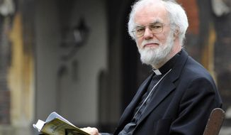Archbishop of Canterbury Rowan Williams reads the Book of Common Prayer in the grounds of Lambeth Palace, in London on March 16, 2012. Williams says he is stepping down at the end of the year, closing a tumultuous decade as leader of a global Anglican communion sharply divided on issues of sexuality and gender. (Associated Press/PA Wire)