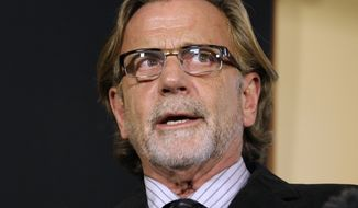 John Henry Browne, the attorney representing the U.S. soldier who is accused of killing 16 Afghan civilians, talks to reporters, Thursday, Mar. 15, 2012, in Seattle. (AP Photo/Ted S. Warren)