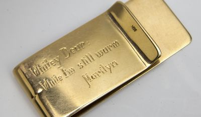 """This undated image released by Julien's Auctions shows a Tiffany's money clip, gifted to Allan """"Whitey"""" Snyder from Marilyn Monroe. This item is part of Julien's Auctions Hollywood Legends being held March 31 and April 1, 2012, in Beverly Hills, Calif. (Associated Press/Julien's Auctions)"""